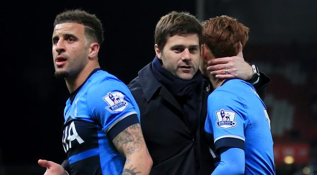 Mauricio Pochettino, centre, was proud of Tottenham's display at Stoke
