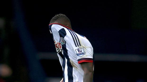 West Brom striker Saido Berahino hides his head after seeing one of two penalties saved by Watford keeper Heurelho Gomes