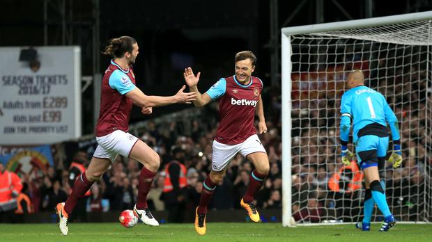 Andy Carroll, left, and Mark Noble, West Ham's goalscorers, celebrate going 3-0 up