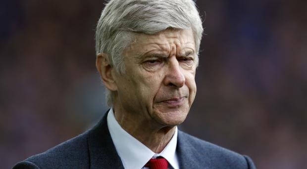 Arsene Wenger insists he will at least see out his current contract at Arsenal