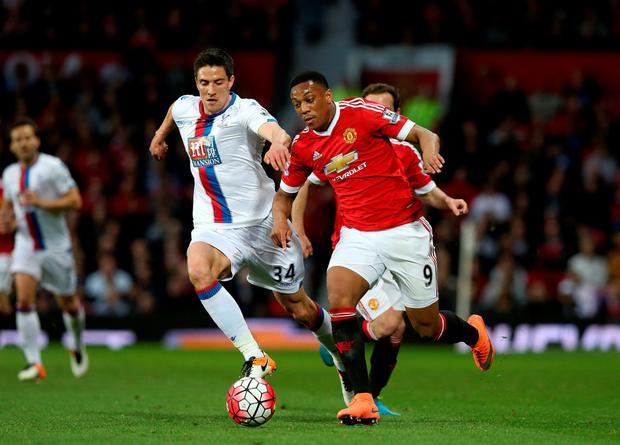 Race on: United's Anthony Martial takes on Crystal Palace's Martin Kelly