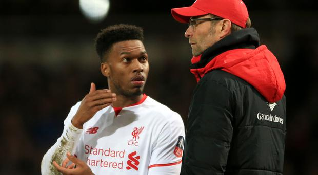 Liverpool manager Jurgen Klopp, right, does not expect Daniel Sturridge to carry the goalscoring burden as the club's only fit striker.