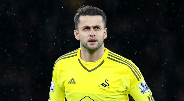 Swansea Lukasz Fabianski could give Tottenham a helping hand in the title race at Leicester