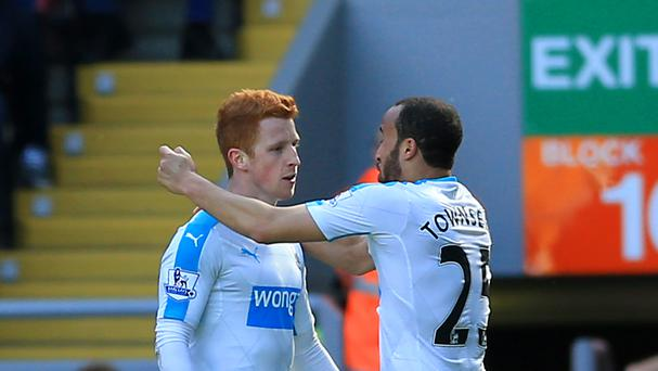 Jack Colback, left, salvaged a point for Newcastle at Anfield