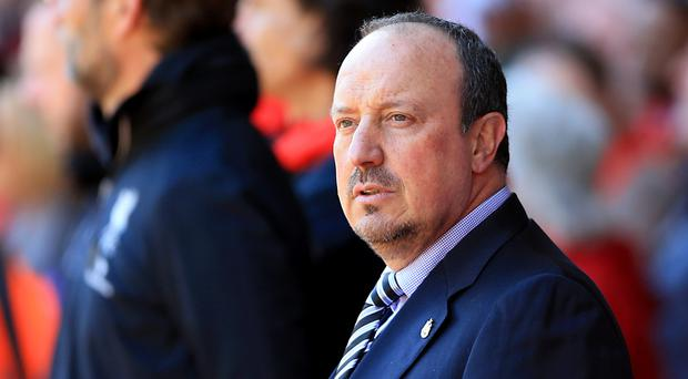 Rafael Benitez's Newcastle rallied after the break with two goals levelling things up for a vital point
