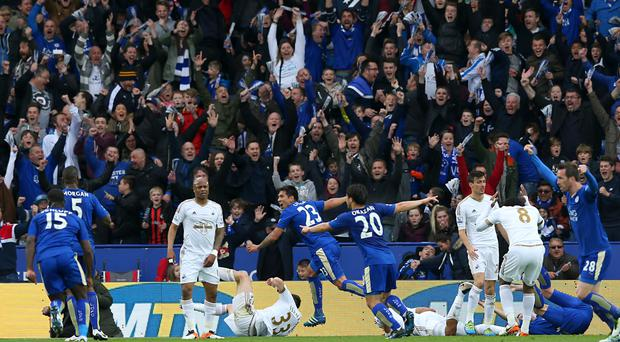 Leicester took a step closer to the title without top scorer Jamie Vardy by beating Swansea 4-0.