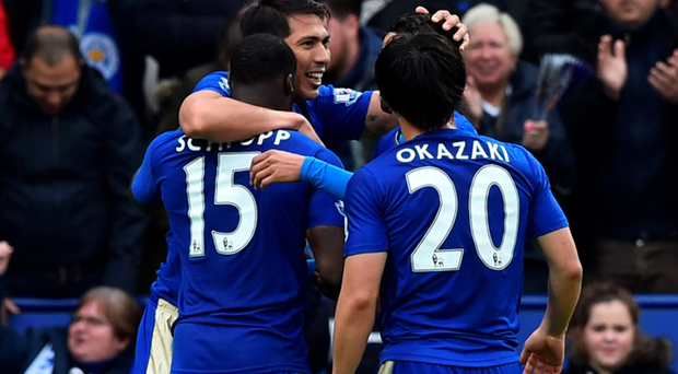 Centre of attention: Leonardo Ulloa is hailed by his Leicester team-mates after hitting a double in the 4-0 win over Swansea