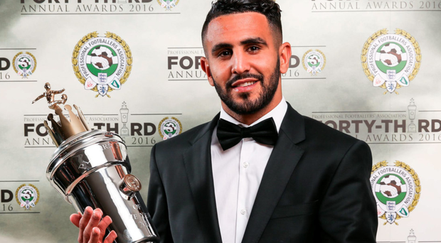 Riyad Mahrez with his PFA Player of Year trophy