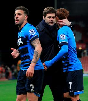 In it together: Mauricio Pochettino embraces Son Heung-Min (right) and Kyle Walker and says he can feel the trust between his Spurs players