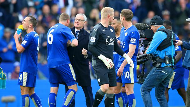 Leicester City manager Claudio Ranieri, third from left, congratulates the players after their win on Sunday