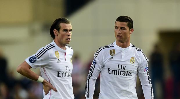 Gareth Bale (left) says he and Cristiano Ronaldo get on well.