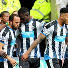Newcastle's Andros Townsend (centre left) is congratulated by team-mates