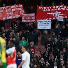 A minority of Arsenal fans displayed banners calling for Arsene Wenger's departure