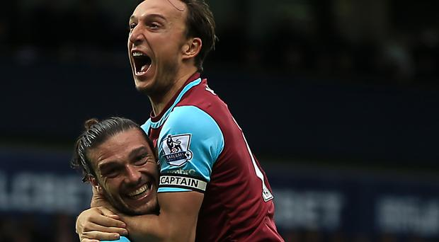 Mark Noble, right, and Andy Carroll celebrated a 3-0 win at West Brom