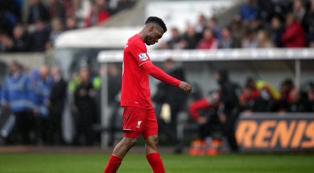 Daniel Sturridge appeared dejected as he heads off without acknowledging the Liverpool fans after their 3-1 defeat at Swansea.