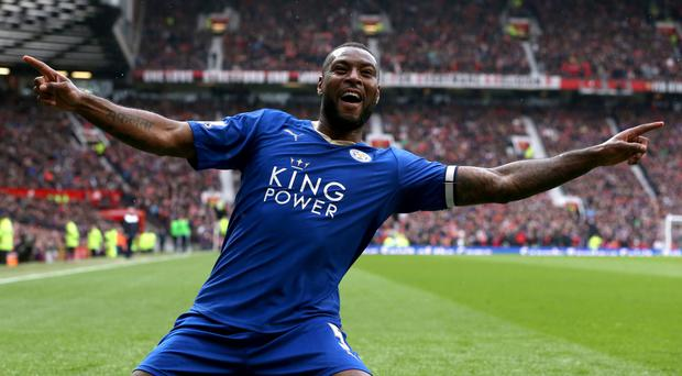 Wes Morgan earned a point for Leicester at Manchester United but they must wait for the title