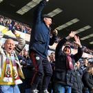 Burnley fans celebrate in the stands after Sam Vokes' goal