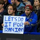A Chelsea fan shows his support for Leicester manager Claudio Ranieri