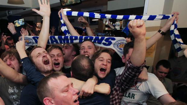 Leicester City fans celebrate winning the title