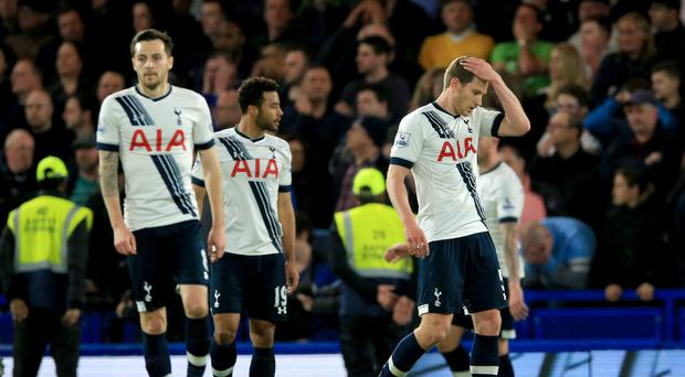 Mousa Dembele, pictured centre, had a night to forget