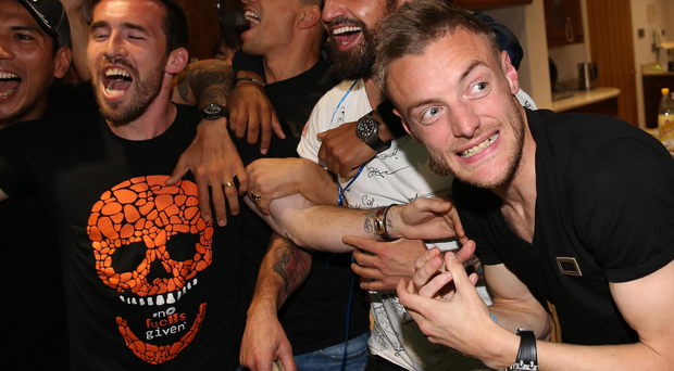 Party time: Jamie Vardy (right) and Leicester team-mates celebrate title success last night