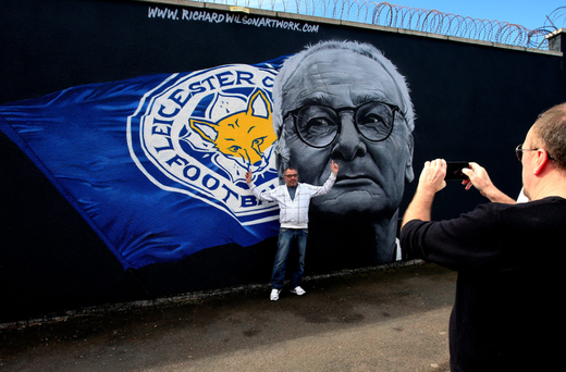 Picture perfect: A Leicester fan poses at a new Claudio Ranieri mural