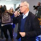 Cheers to that: Claudio Ranieri toasts Leciester's Premier League triumph