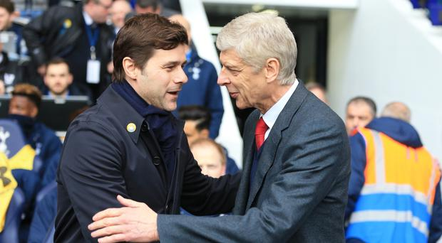 Mauricio Pochettino, left, is not focused on finishing above Arsene Wenger's, right, Arsenal