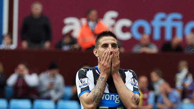Aleksandar Mitrovic is dejected after missing a chance to score in Newcastle's 0-0 draw at Aston Villa