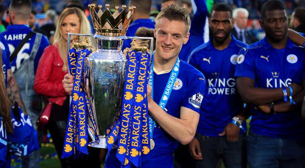 Leicester striker Jamie Vardy holds the Premier League trophy