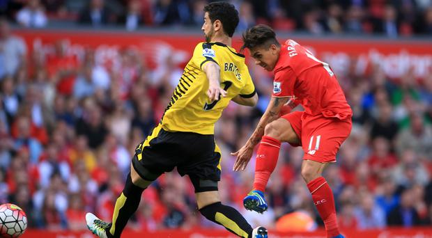 Liverpool's Roberto Firmino strikes the second goal against Watford