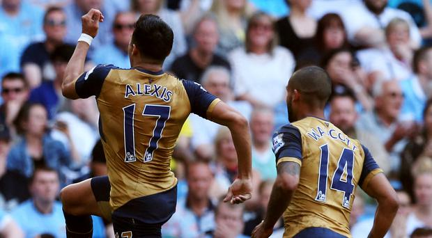 Arsenal's Alexis Sanchez (left) celebrates scoring his side's second goal