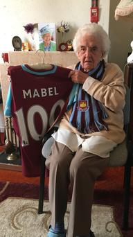 100-year-old West Ham United fan Mabel Arnold, who was presented with a home shirt in front of the crowd at Upton Park to celebrate her 100th birthday in April.