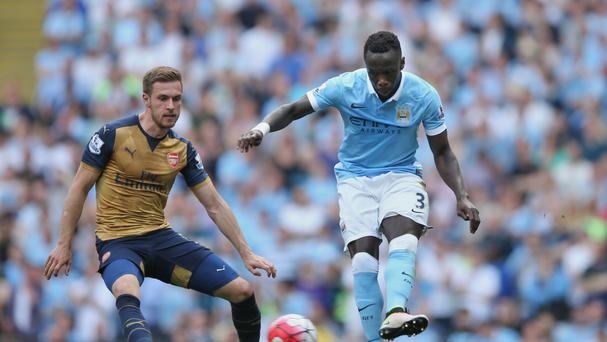 Manchester City's Bacary Sagna, right, is not giving up on Champions League football