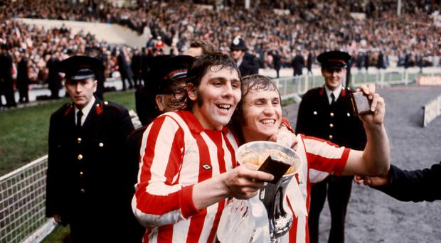 Matchwinner Ian Porterfield, pictured left with Dennis Tueart, parade the FA Cup after Sunderland's 1973 victory at Wembley