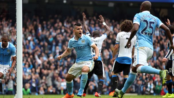 Sergio Aguero scores one of five goals for Manchester City in their rout of Newcastle