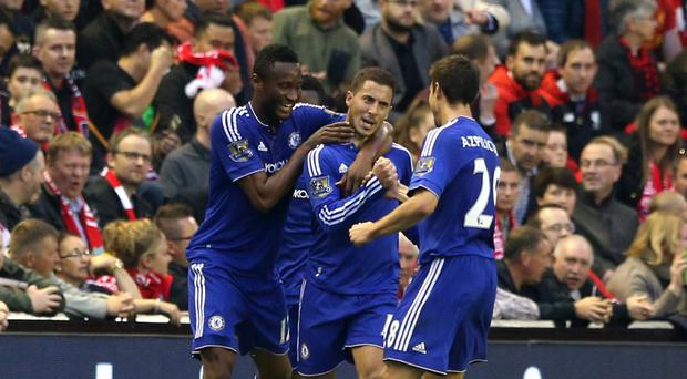Chelsea's Eden Hazard, centre, celebrates scoring against Liverpool