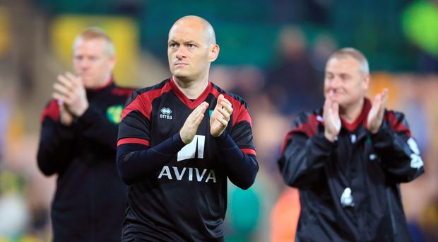 Norwich City manager Alex Neil looks dejected as he applauds the fans following confirmation of his club's relegation