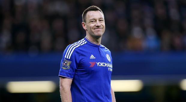 Guus Hiddink is hopeful there will be a resolution to John Terry's, pictured, future at Chelsea