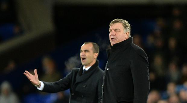 Sunderland boss Sam Allardyce, right, says Roberto Martinez, left, should have been given more time at Everton