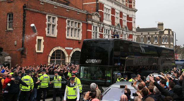 The Manchester United coach was pelted with bottles before the clash with West Ham