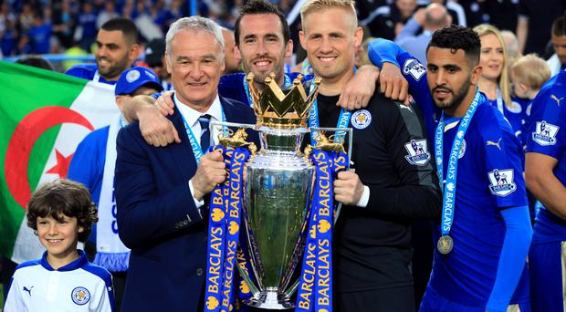 Leicester manager Claudio Ranieri (left), Christian Fuchs (centre), goalkeeper Kasper Schmeichel and Riyad Mahrez (right) with the Barclays Premier League trophy.