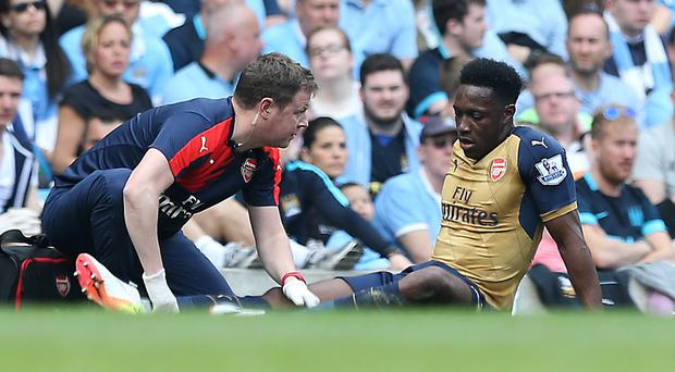 Arsenal's Danny Welbeck, right, is facing nine months out