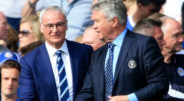 Claudio Ranieri shakes hands with Guus Hiddink, right, after the final whistle