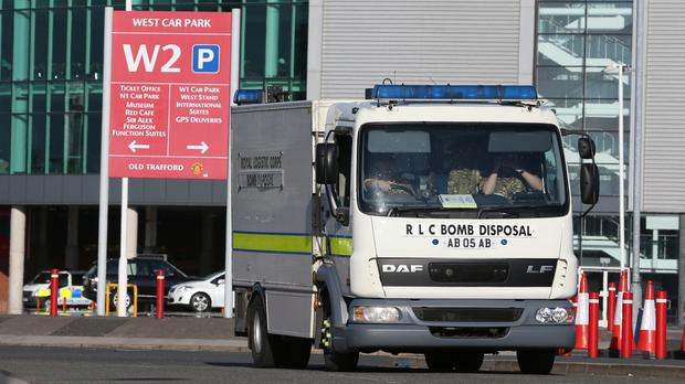 A bomb disposal van leaves Old Trafford