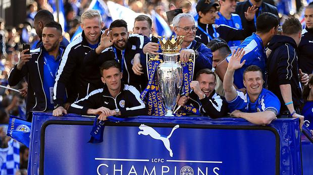 Danny Drinkwater, second right, celebrates Leicester's title win during their bus parade on Monday.
