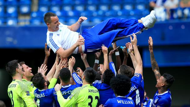 Chelsea captain John Terry (centre) has agreed a contract extension to stay at Stamford Bridge for next season