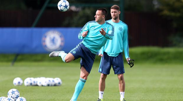 John Terry, left, signed a new deal this week giving team-mates like Gary Cahill, right, a boost