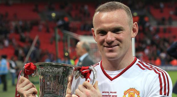 Manchester United's Wayne Rooney got his hands on the FA Cup for the first time