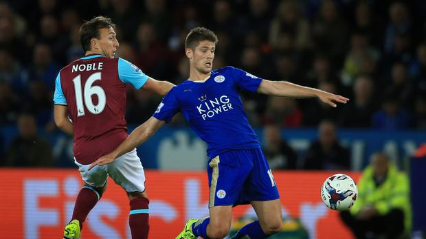 Leicester City's Andrej Kramaric has his shirt pulled by West Ham United's Mark Noble (left) during the Capital One Cup, third round match at the King Power Stadium, Leicester.